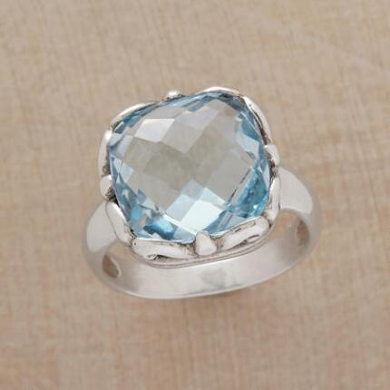 The sparkle of this blue topaz bombshell ring will blow you away.