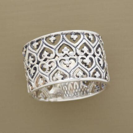 Delicately romantic, this silver heart filigree band ring will capture your affection.