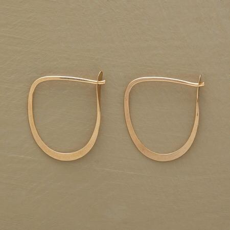 This golden pair of Melissa Joy Manning 14kt hoop earrings has a classic design you can wear with anything.