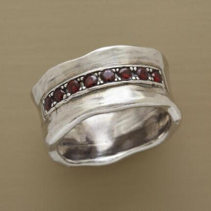 You'll adore the broad band and delicate accents of this red garnet guardian ring.