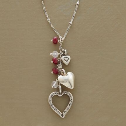 This heart pendant and gemstones necklace makes a sweet touch in any ensemble.