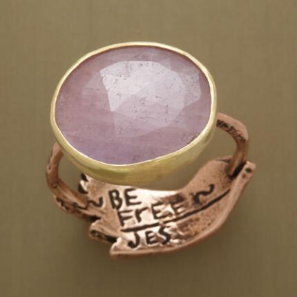Rosy and sublime, this pink sapphire peace ring brings serenity to mind.