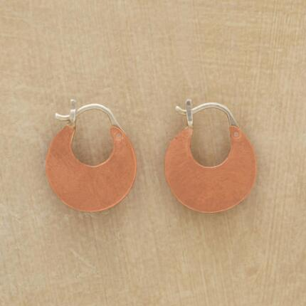 Warmly chic, these copper crescent hoop earrings make a glowing touch in any ensemble.
