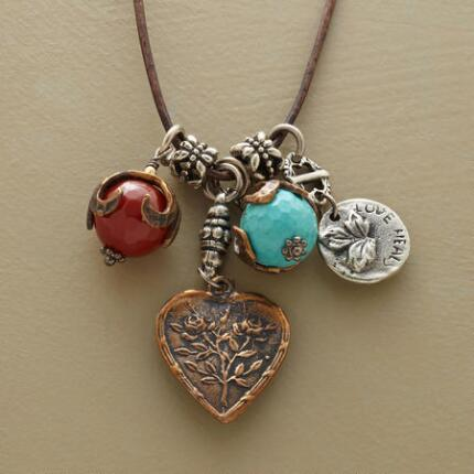 The intricately worked pendants on this lovely love charms necklace make it a truly unique piece.