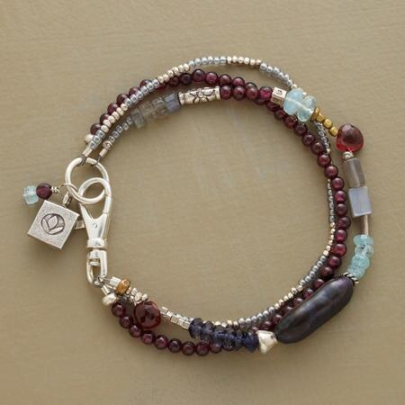 This handmade garnet, sterling and gemstone bracelet glows with warmth and cool elegance by turns.