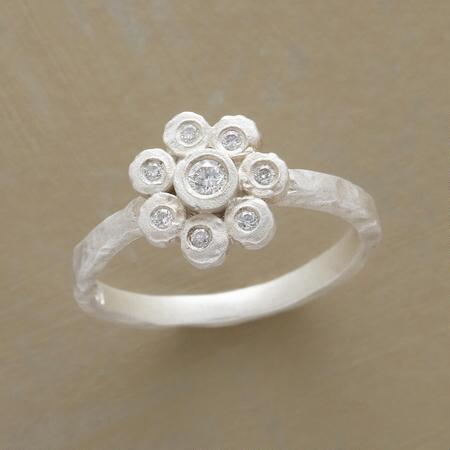 Sweet and sparkly, this diamond daisy ring delivers the everyday glitter you've been looking for.