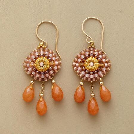 A dazzling pair of carnelian sun goddess earrings, emblazoned with delicate beadwork.