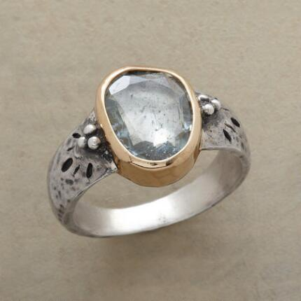 A handmade aquamarine ring with a lovely brightness and winsome accents.