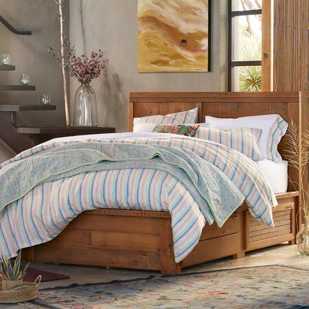 A handsome barnwood platform bed with drawers makes a distinctive organizing principle for any bedroom.