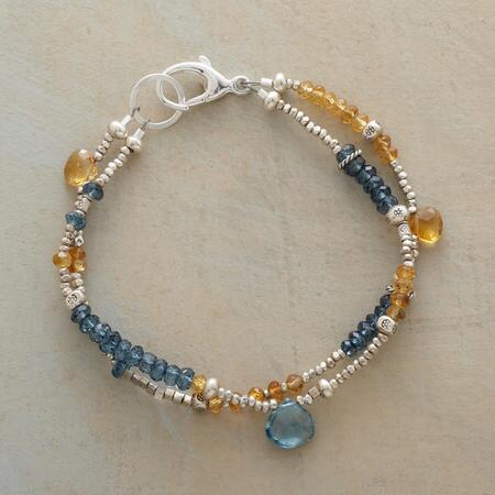 Our citrine and blue quartz bracelet makes a sweet addition to any look.