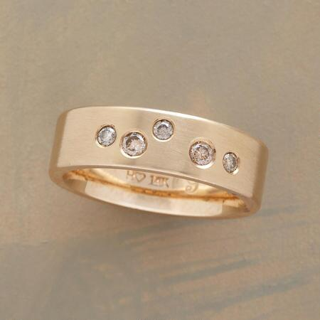 A lovely champagne diamonds gold band ring with an air of effervescence.