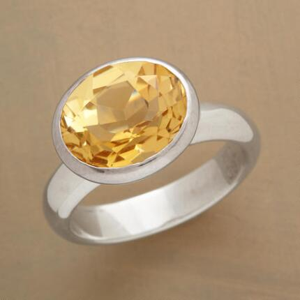 The jewel in this citrine buttercup ring emits an uncontainable luminescence.