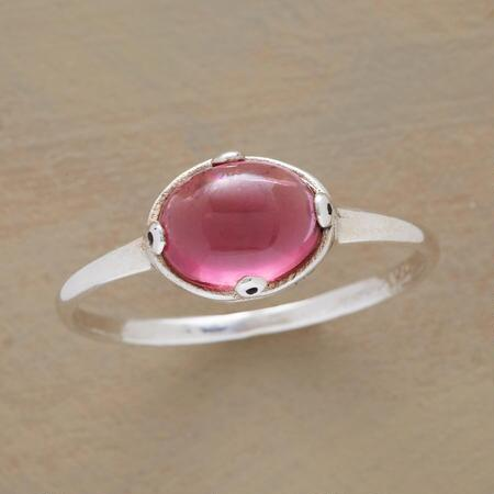 The way this pretty pink tourmaline loop ring blushes will simply charm you.