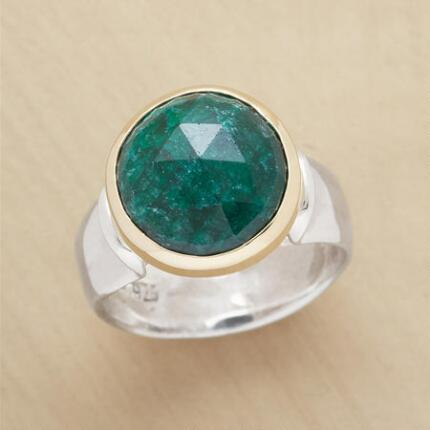The rose-cut emerald ring's deeply colored and prominent stone make a stunning focal point for your look.