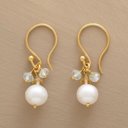 These dangling pearl and citrine earrings simply glow with delicate beauty.