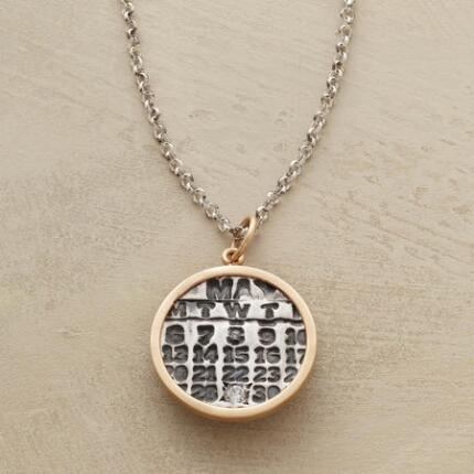 This personalized diamond date charm necklace marks a shining occasion with a sparkling jewel.
