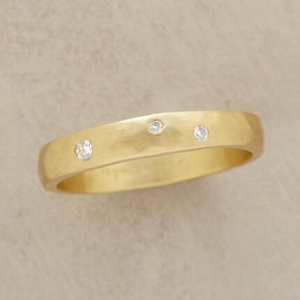 A diamond stars gold ring that will bring a subtle touch of sparkle into your day.