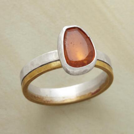 Uniquely colored and designed, this hessonite garnet silver and brass ring is one of a kind.