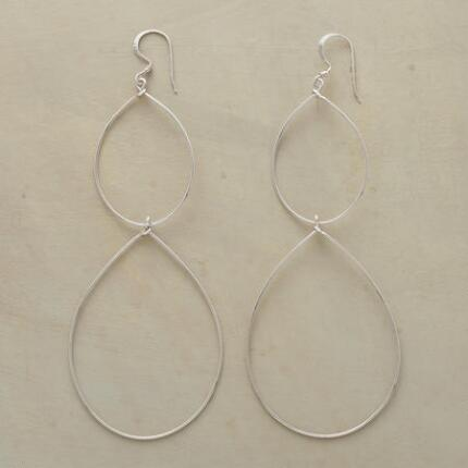 This pair of silver double teardrop hoop earrings makes a striking statement.