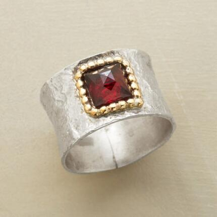 The broad band of this square garnet hammered ring is the perfect canvas for a stone framed in gold.