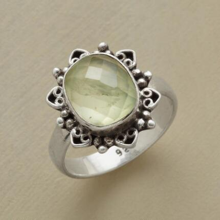 A Merlin's prehnite crown ring characterized by a subtle mystique.