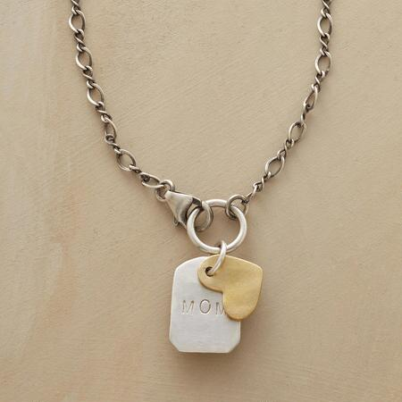 Simple and sweet, this love to mom necklace embodies an endearing sentiment in a lovely design.