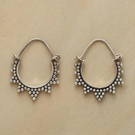 A pair of silver bead starburst hoop earrings, delicately crafted in a chic design.