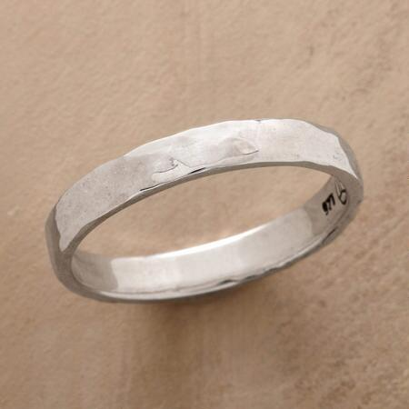 A classic hammered sterling silver band ring that will surely become a go-to accessory.