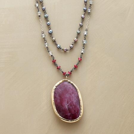 A Jes MaHarry ruby pendant necklace that stuns with its rosy coloring.