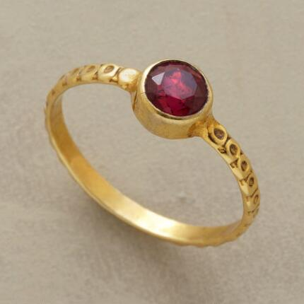 This ruby solitaire ring will seduce you with its resonant hues and elegant design.