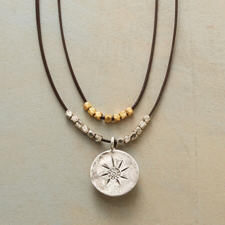 A sunburst pendant leather necklace that adds a bright touch to any outfit.