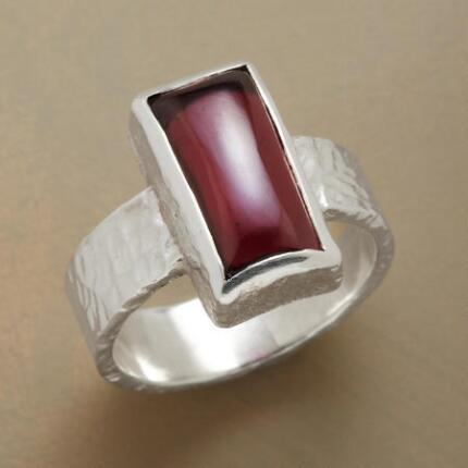 This red garnet & silver ring will add a bold flavor to your look.