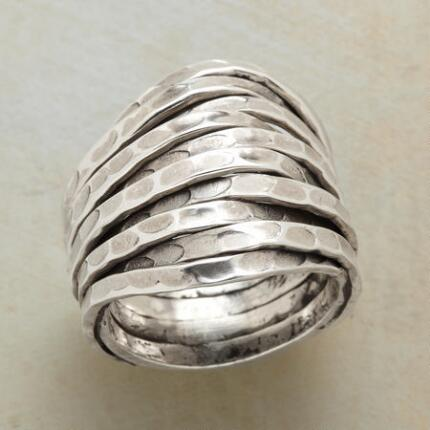 With an almost organic design, this hammered sterling silver wave ring adds a special splash to any outfit.