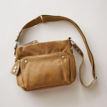 This lamb leather crossbody organizer bag sports a sleek design that's as chic as it is handy.