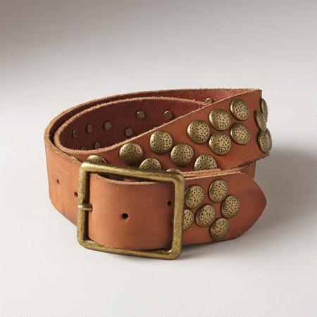 This studded leather belt brings a rustic sense of charm to an oft-edgy motif.
