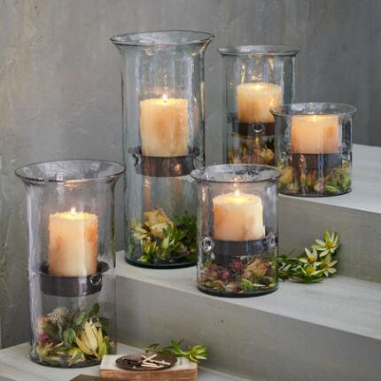A glass hurricane candleholders set that makes a beautiful centerpiece.