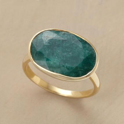 This green corundum handcrafted ring will bring a bit of color into your outfit.