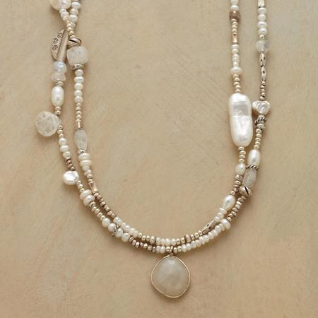 This modern girl's pearl necklace updates a classic design with excitingly unique details.