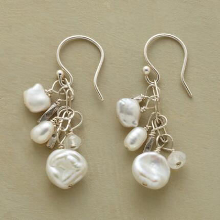 A pair of modern girl's pearl and moonstone earrings that dangle delicately.