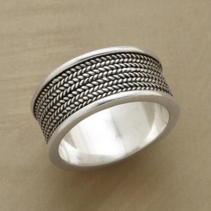 This sterling silver coil band ring embellishes a classic profile with delicate texture.