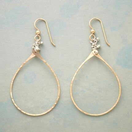 These unique handmade teardrop earrings add a delightful, subtle twist to a classic design.