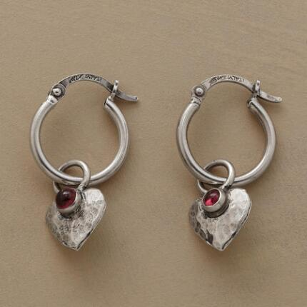 These garnet heart hoop earrings dangle endearingly from the ear.