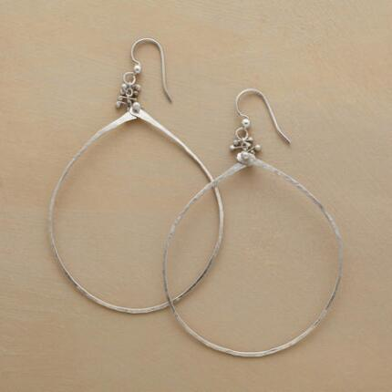 A pair of silver beaded hoop earrings, with a subtle cluster of sterling dots atop a generous loop.