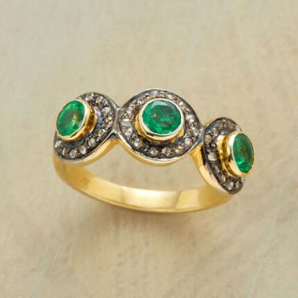 The three verdant stones of this green emerald delight ring crowd the band with lush loveliness.