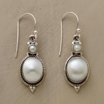 This pair of handmade pearl and sterling earrings has a truly romantic grace.