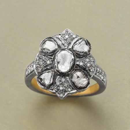 This unique diamond & silver ring makes a distinctly glamorous statement.