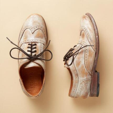 These handmade Oxford shoes finish a time-honored designed with unique flair.