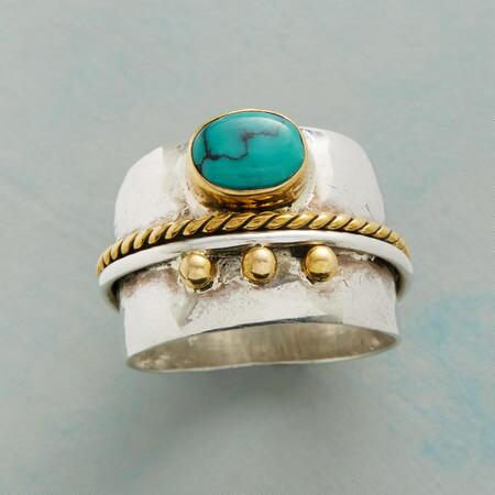 You'll love the unique design of this turquoise brass & silver ring.