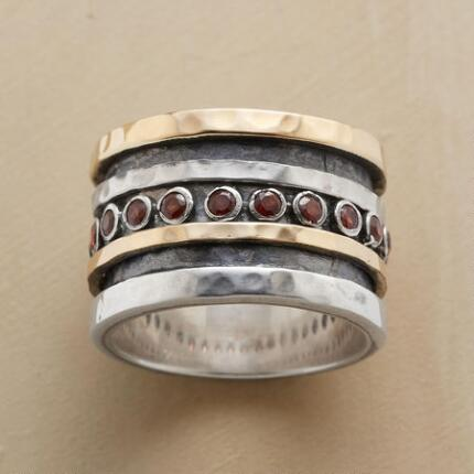 You'll find the planets aligned in your favor when you wear this planetary passions ring.