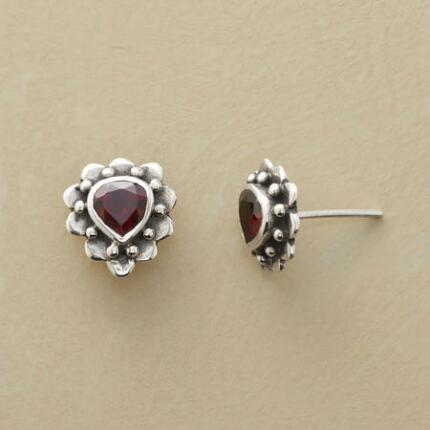 These silver and garnet flower stud earrings charm with their timeless design.